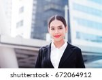 young business woman in the big ... | Shutterstock . vector #672064912