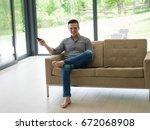 young handsome man enjoying... | Shutterstock . vector #672068908