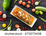 papaya salad with salted egg ... | Shutterstock . vector #672073438