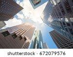 upward view of skyscrapers... | Shutterstock . vector #672079576
