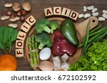 Stock photo natural sources of folic acid as liver asparagus broccoli eggs salad avocado yeast nuts 672102592