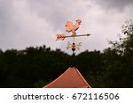 Bronze Weathervane Against A...
