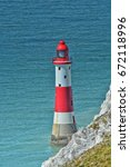 beachy head lighthouse ...   Shutterstock . vector #672118996