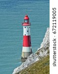 beachy head lighthouse ... | Shutterstock . vector #672119005
