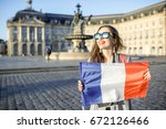 young and happy woman tourist... | Shutterstock . vector #672126466