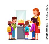 kids group girls  boys watching ... | Shutterstock .eps vector #672127072