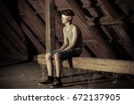 lonely teenage male prisoner... | Shutterstock . vector #672137905