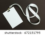 Small photo of Blank badge or ID pass isolated on brown background, clipping path included