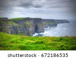 ireland's cliffs of moher | Shutterstock . vector #672186535