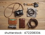 Small photo of closeup vintage style of digital mirrorless camera with leather strap and other EDC for men.