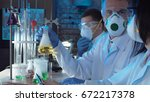 group of chemists working in a... | Shutterstock . vector #672217378