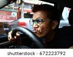 man wearing glasses waiting for ... | Shutterstock . vector #672223792