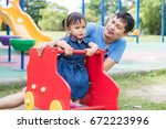 father and daughter playing... | Shutterstock . vector #672223996
