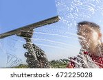 Washing and cleaning the window with a squeegee