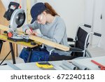 disabled female worker in...   Shutterstock . vector #672240118