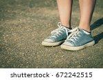 legs in sneakers | Shutterstock . vector #672242515