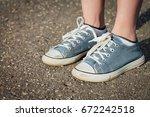 legs in sneakers | Shutterstock . vector #672242518