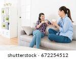 beautiful pretty girls holding... | Shutterstock . vector #672254512
