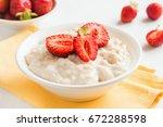 oatmeal porridge with... | Shutterstock . vector #672288598