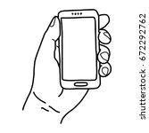 left hand holding small mobile...   Shutterstock .eps vector #672292762