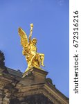 Small photo of Golden statue of Eros, Dresden, Saxony, Germany. Vintage style.