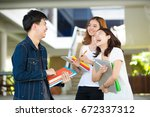 young asian students talk...   Shutterstock . vector #672337312
