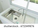 brand new sink in kitchen | Shutterstock . vector #672349876