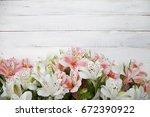 alstroemeria flowers background.... | Shutterstock . vector #672390922