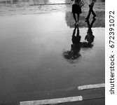 rain. reflection of people with ... | Shutterstock . vector #672391072