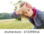 exhausted woman after jogging... | Shutterstock . vector #672398416