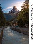 matterhorn viewpoint and river... | Shutterstock . vector #672405616