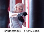 close up of boxing elderly lady | Shutterstock . vector #672426556