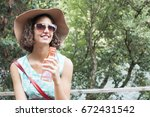 girl with a bottle of water in... | Shutterstock . vector #672431542
