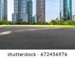 empty asphalt road front of... | Shutterstock . vector #672456976