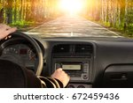 man driving a car. listening to ...   Shutterstock . vector #672459436