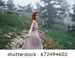 woman in the forest  fog        ...   Shutterstock . vector #672494602