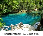 enchanted river in hinatuan ... | Shutterstock . vector #672505546