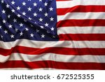 flag of the usa with sunflare | Shutterstock . vector #672525355