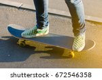 skateboarder girl's legs in... | Shutterstock . vector #672546358
