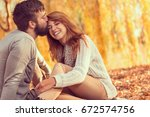 couple in love sitting on... | Shutterstock . vector #672574756