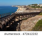 sidewalk on cliff  in algarve... | Shutterstock . vector #672612232