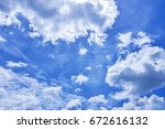 the vast blue sky and clouds... | Shutterstock . vector #672616132
