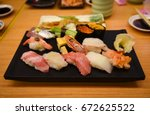 raw and fresh mix sushi set in... | Shutterstock . vector #672625522