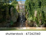 Waterfall And Grotto In The...