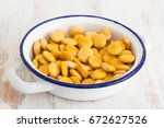 salted lupins in white dish | Shutterstock . vector #672627526