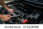 hand of mechanic is repairing... | Shutterstock . vector #672628588