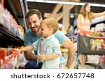 family in the supermarket. soft ... | Shutterstock . vector #672657748
