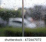 water drop on glass background | Shutterstock . vector #672667072