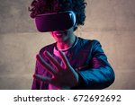 cheerful girl having the vr... | Shutterstock . vector #672692692