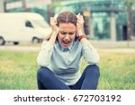 portrait stressed crying... | Shutterstock . vector #672703192